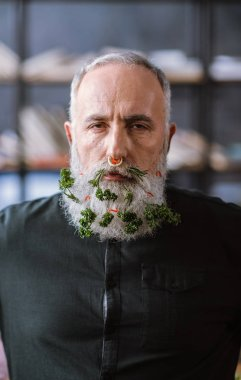 Senior man with greens in beard