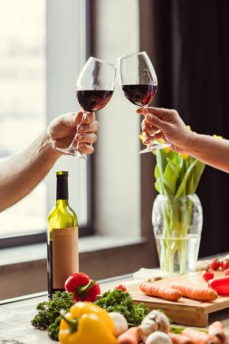 Couple cheering with wine
