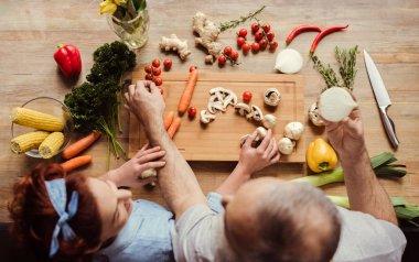 Couple preparing vegan food