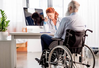 Doctor and patient in wheelchair