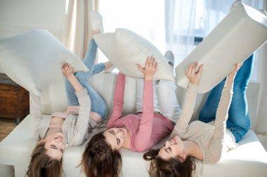 Women lying on sofa