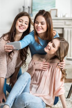 Women taking selfie