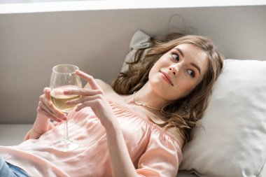 Woman holding glass of wine