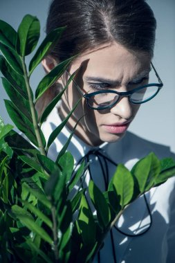 Hipster woman in white shirt with plant