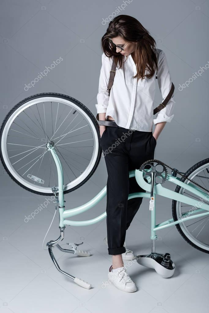 hipster woman with bicycle