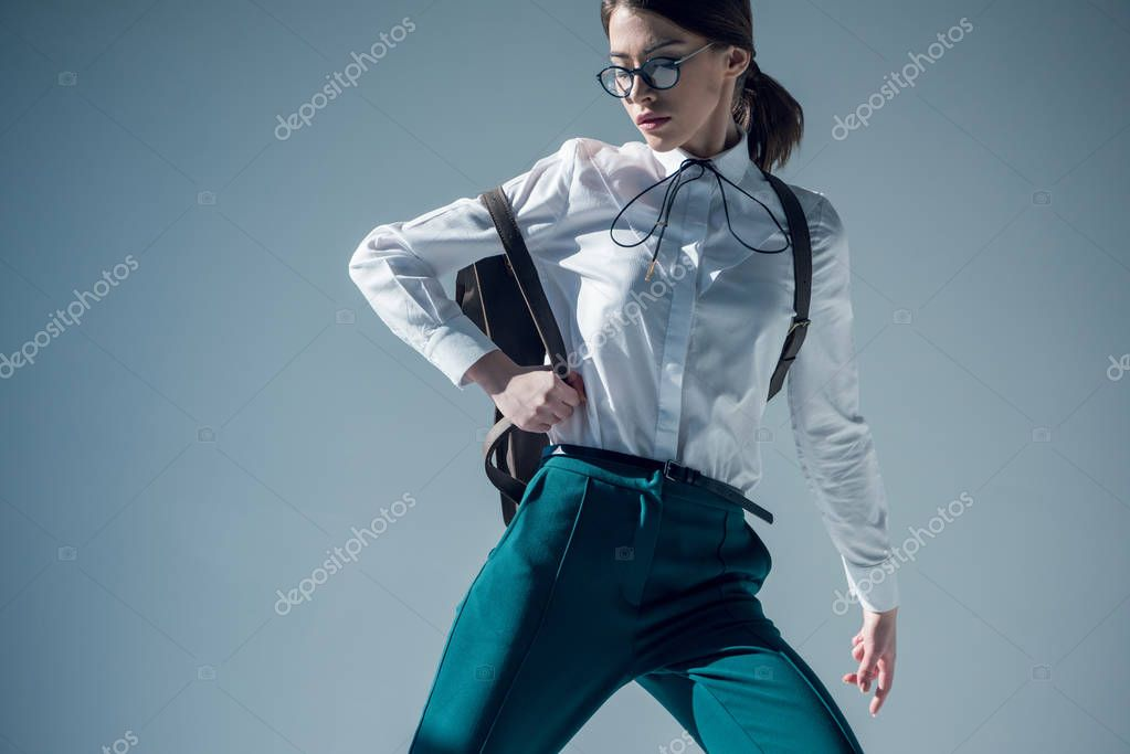 Stylish hipster woman in white shirt, green trousers and glasses with backpack stock vector