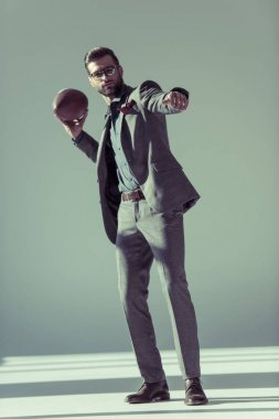 Stylish man with rugby ball