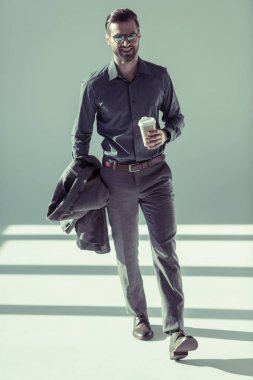 Handsome man with paper cup