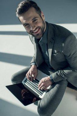 stylish businessman using laptop