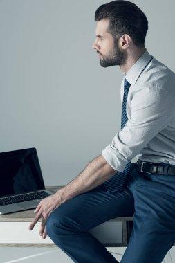 businessman sitting on table