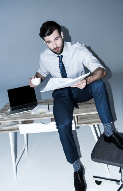 businessman sitting on table