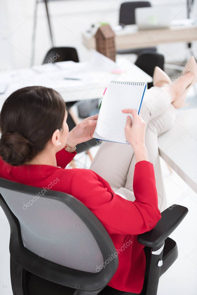 businesswoman analyzing notes