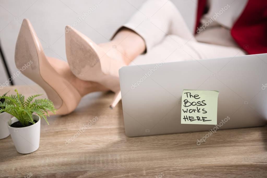 female legs near laptop