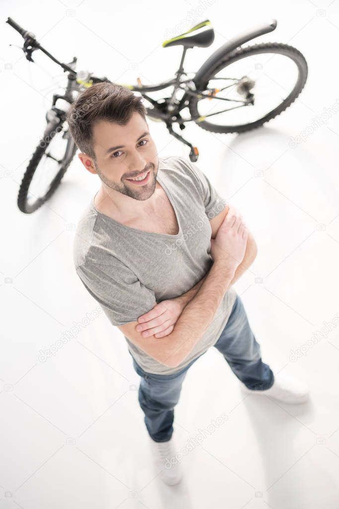 Confident man with bicycle