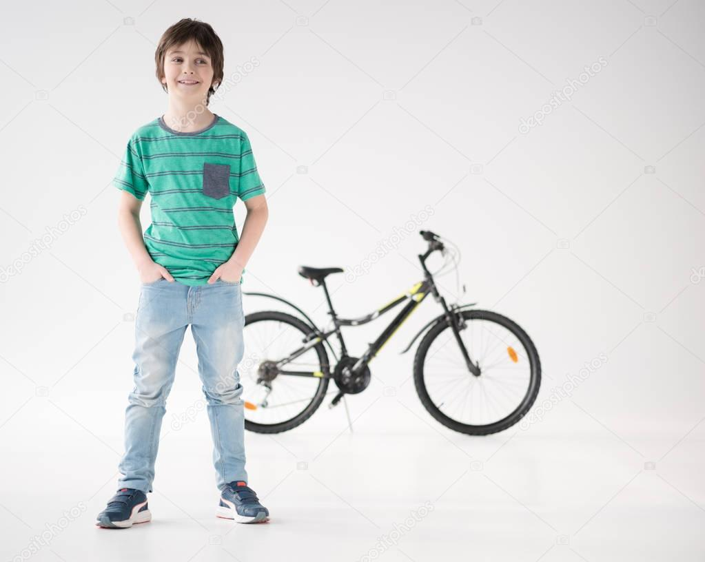 smiling boy with bicycle
