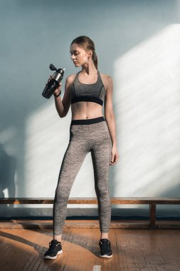 Sporty woman with bottle of water