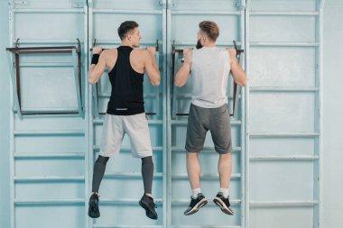 sporty men exercising in gym