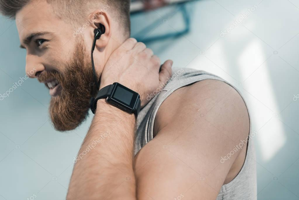 sporty man with smartwatch