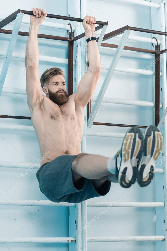 sporty man exercising in gym