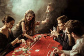 Fotografie young people playing poker