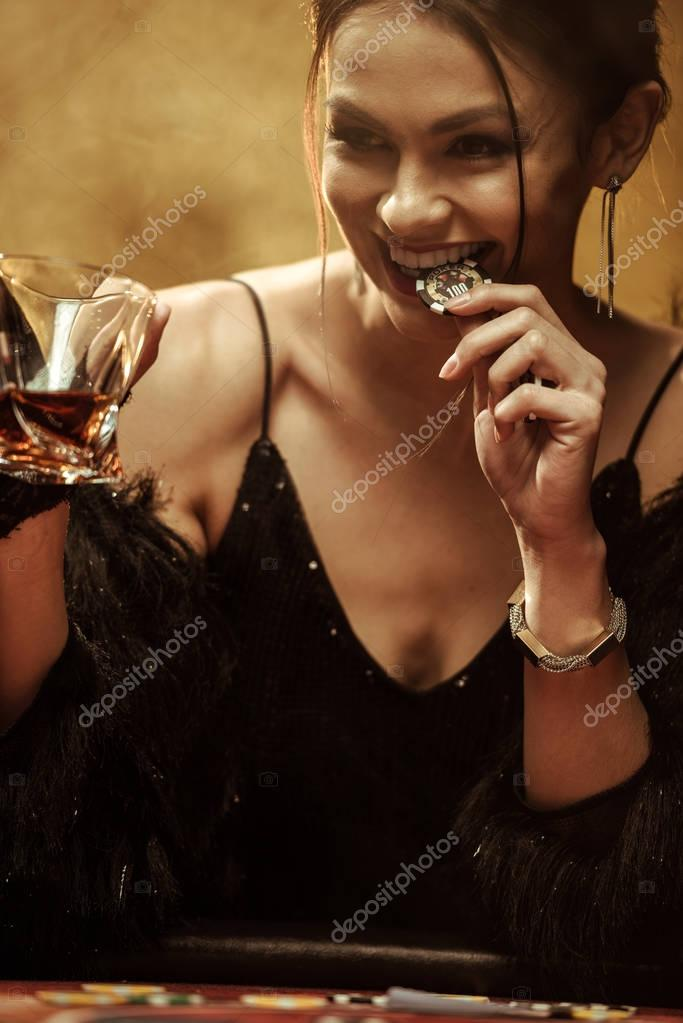 Gorgeous woman at poker table