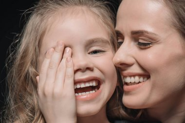 daughter and mother laughing