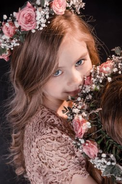 Girl with flowers wreath