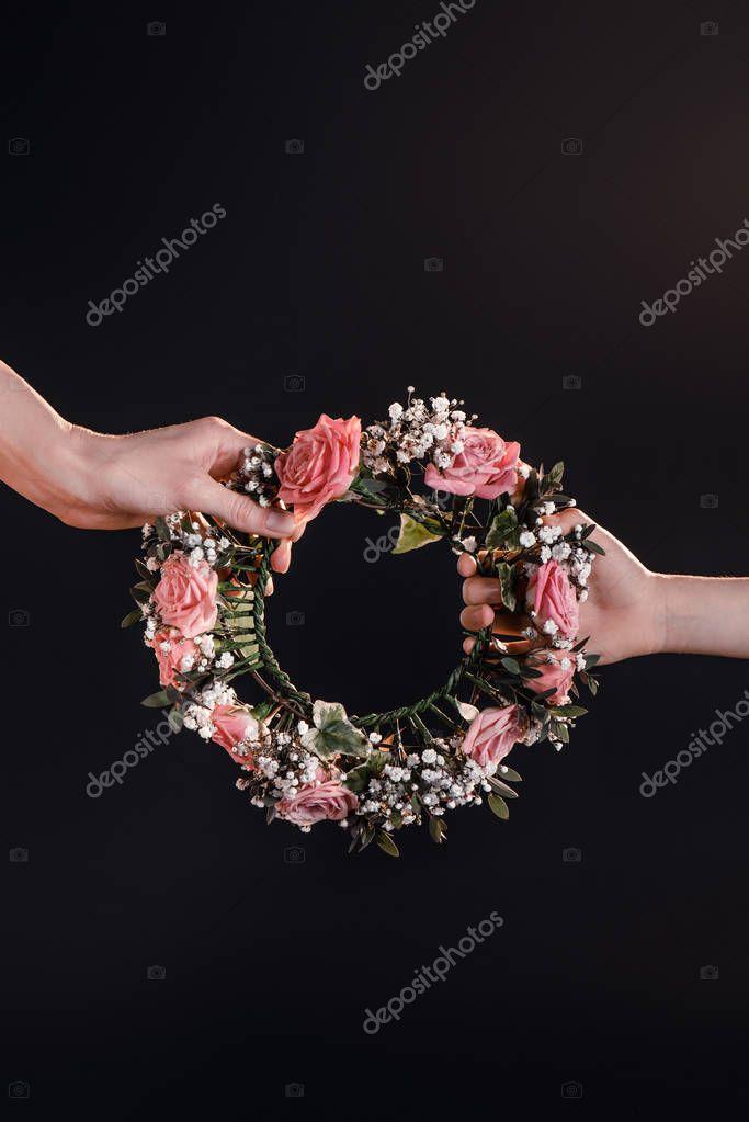 hands holding wreath