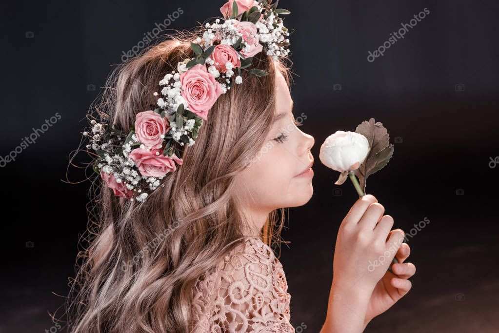 Girl in wreath with flower