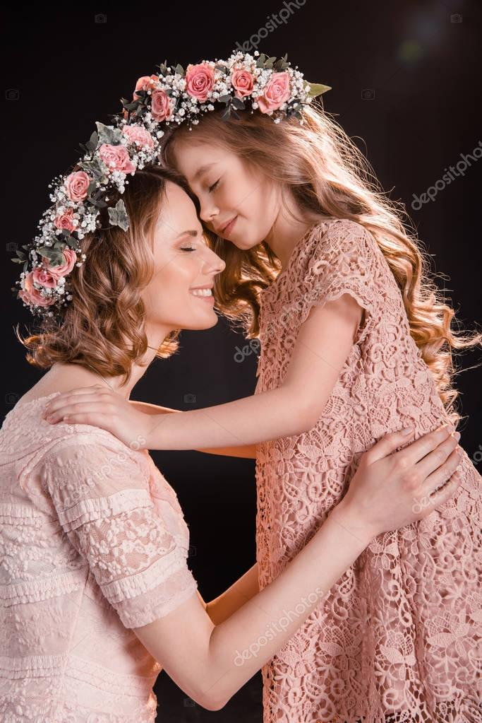 Mother and daughter in wreaths