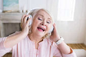 Fotografie Senior woman in headphones