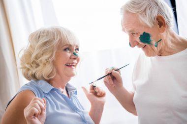 Portrait of happy senior man and woman in art workshop stock vector