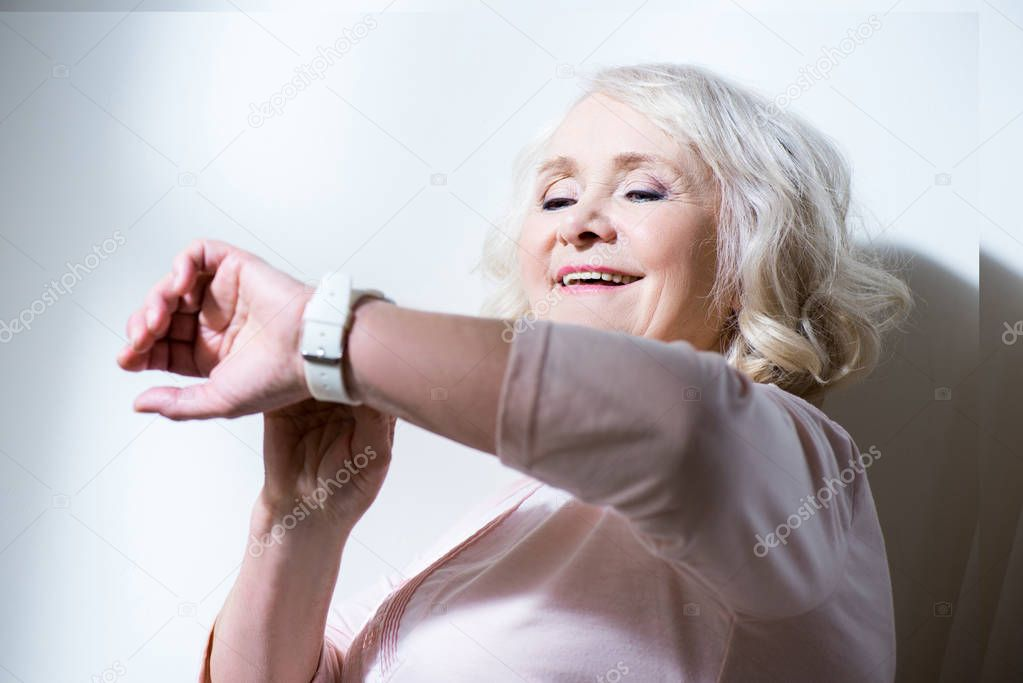 Senior woman with smartwatch