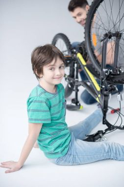father and son with bicycle