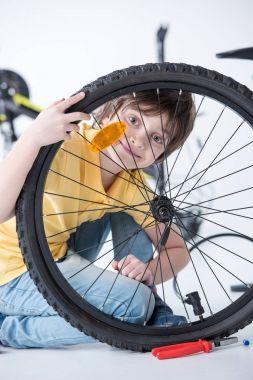Boy repairing bicycle