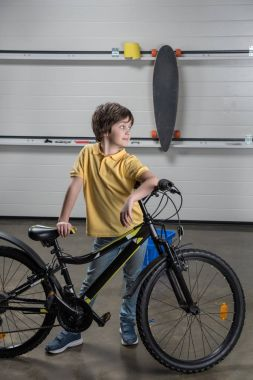 Little boy with bicycle