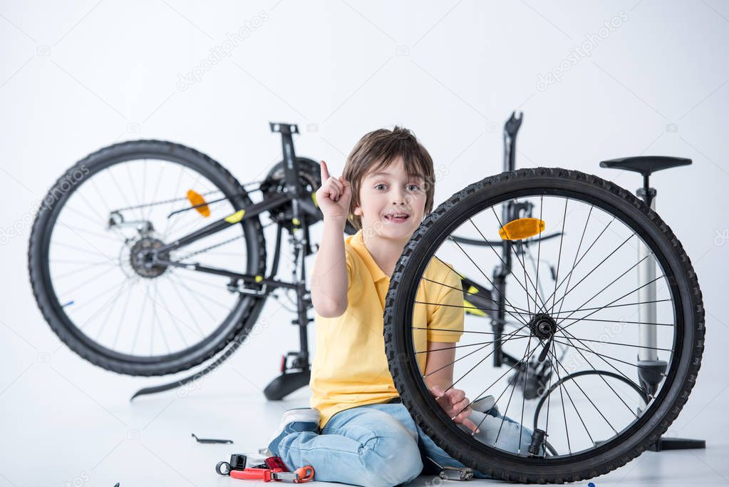 Boy repairing bicycle