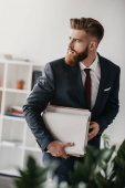 businessman holding documents and folders
