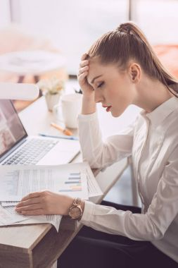 Tired businesswoman with laptop