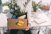 Fotografie Fired businesswoman holding box