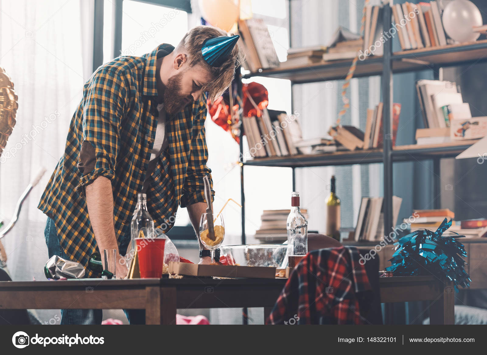 Cleaning Messy Room man cleaning messy room — stock photo © arturverkhovetskiy #148322101