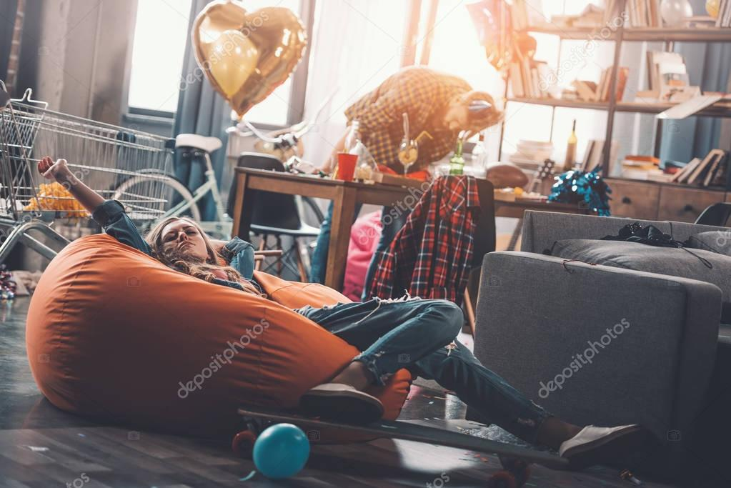 tired woman resting on beanbag chair