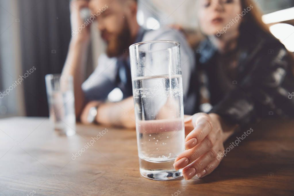 man and woman with hangover