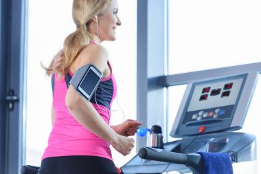 Sporty woman on treadmill