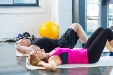Sporty man and woman in gym