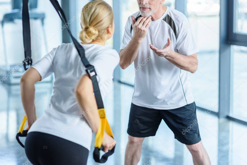 sportswoman training with resistance band