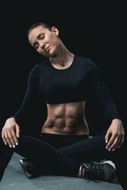 sportswoman stretching neck