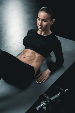 sportswoman doing abs