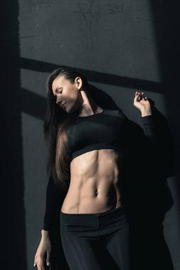 Young brunette sportswoman