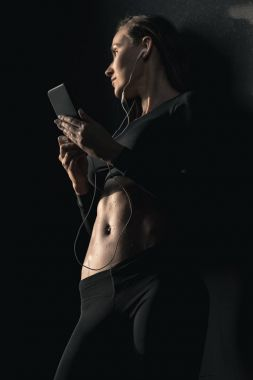 Sporty woman using smartphone